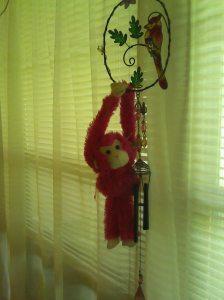 Pink monkey on cardinal